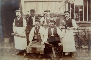 Polden & Feltham workers c1915 L to R: Jimmy Feltham; unknown; Clement Polden; Geoff Feltham; Alfred Burt; Lewis Daniels