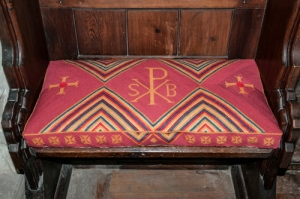 One of the new priests' seat cushions featuring the Salisbury Plain Benefice symbol